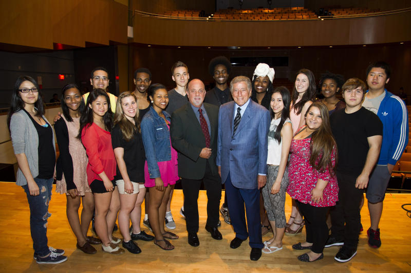 Billy Joel, center left, and Tony Bennett, center right, pose with students on stage before a special master class school-wide assembly event for the Frank Sinatra School of the Arts, the public high school Bennett founded, on Thursday, May 30, 2013 in New York. (Photo by Charles Sykes/Invision/AP)