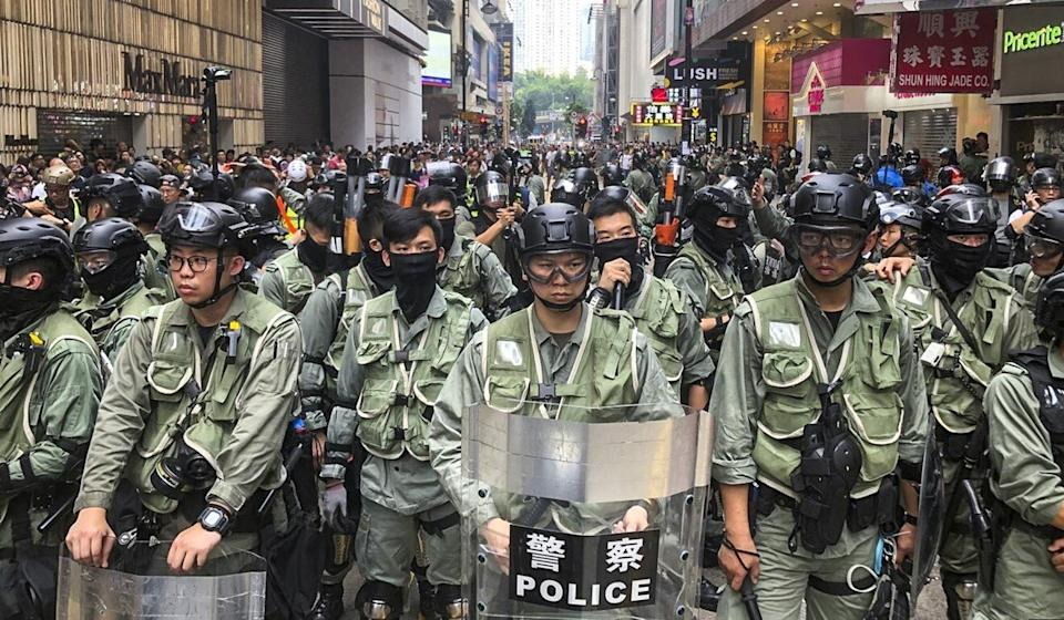 Riot police wait on Great George Street, Causeway Bay, as protesters gather for a march in September, 2019. Photo: Sam Tsang