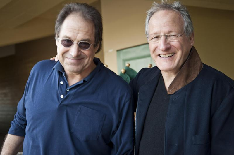 "In this undated image released by HBO, David Milch, left, and Michael Mann are shown on the set of the HBO racing series ""Luck."" Milch and Mann are defending the treatment of horses on their now canceled HBO racetrack series.  The series was canceled last month by HBO after a third thoroughbred died during production of the drama.  (AP Photo/HBO, Gusmano Cesaretti)"