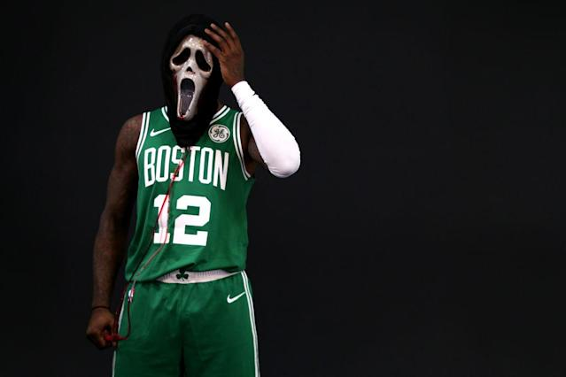 "<a class=""link rapid-noclick-resp"" href=""/nba/teams/bos"" data-ylk=""slk:Boston Celtics"">Boston Celtics</a> guard <a class=""link rapid-noclick-resp"" href=""/nba/players/5476/"" data-ylk=""slk:Terry Rozier"">Terry Rozier</a> wears a Ghost Face mask during a media day photo session. (Getty Images)"