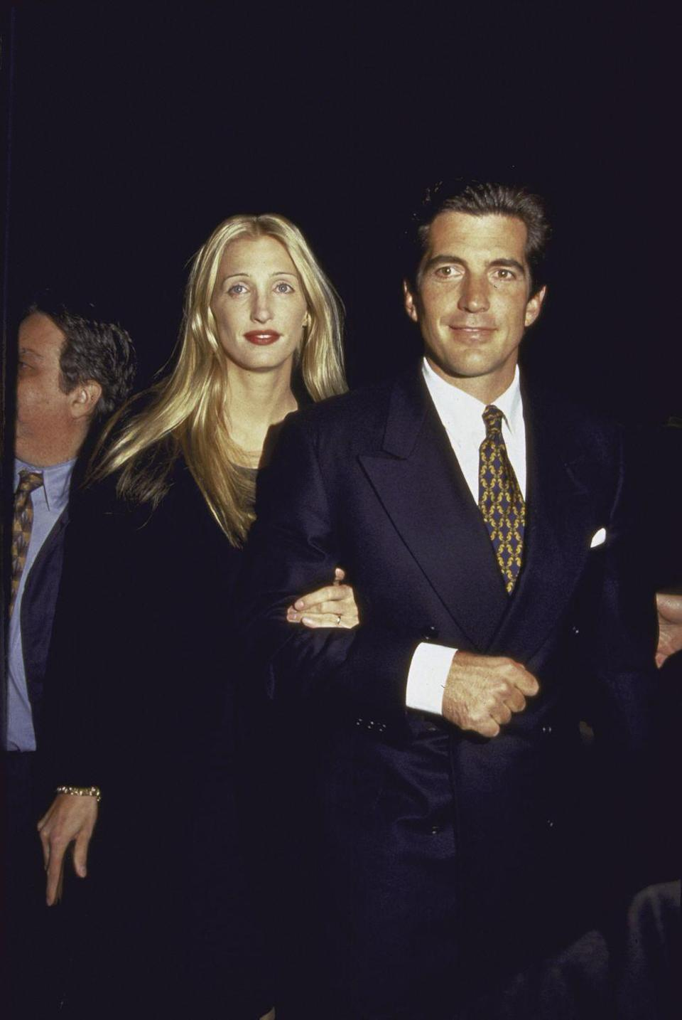 <p>John F. Kennedy Jr. and his wife, Carolyn Bessette, arrive at <em>George</em> magazine's second anniversary party in 1997. The late President's son founded the political-lifestyle publication in 1995. </p>