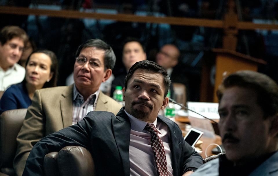 FILE PHOTO: Philippine Senator and boxer Manny Pacquiao (2nd R) sits with Senators Tito Sotto (R), Gregorio Honasan (L), Grace Poe (2nd L) and Panfilo Lacson (3rd L) as they watch a presentation showing the body of Albuera Mayor Rolando Espinosa during a senate hearing investigating Espinosa's death in Manila on November 10, 2016. Espinosa, who President Rodrigo Duterte named as being involved in the illegal drug trade, was shot dead in jail on November 5, police said, the second local official implicated in narcotics to be killed in two weeks. / AFP / NOEL CELIS        (Photo credit should read NOEL CELIS/AFP via Getty Images)