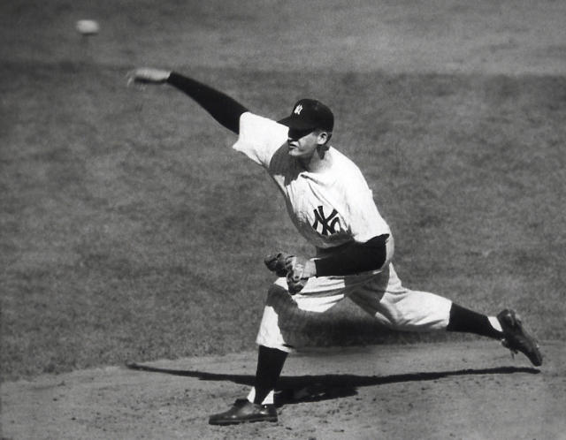 "In this Oct. 8, 1956, file photo, <a class=""link rapid-noclick-resp"" href=""/mlb/teams/ny-yankees/"" data-ylk=""slk:New York Yankees"">New York Yankees</a> pitcher Don Larsen delivers a pitch in the fourth inning of Game 5 of the World Series against the Brooklyn Dodgers. Larsen, who died on Wednesday, is the only player to ever throw a perfect game in the World Series. (AP, File)"