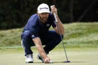 Dustin Johnson lines his putt on the first green during the final round of the BMW Championship golf tournament at the Olympia Fields Country Club in Olympia Fields, Ill., Sunday, Aug. 30, 2020. (AP Photo/Charles Rex Arbogast)