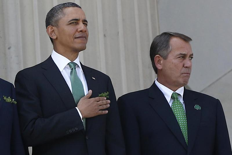 "FILE - In this March 19, 2013 file photo, President Barack Obama stands with House Speaker John Boehner of Ohio after they attended a Friends of Ireland luncheon on Capitol Hill in Washington. The partisan cease-fire that kept the government running this spring gave birth to hopeful talk of a much larger ""grand bargain"" that would reduce the federal deficit for years. But such optimism seems to ignore how far apart the two parties remain on key issues. The mutual obstinance disappoints those who felt top Republicans and Democrats were close to a major accord on spending cuts and tax increases in December.  (AP Photo/Charles Dharapak. File)"