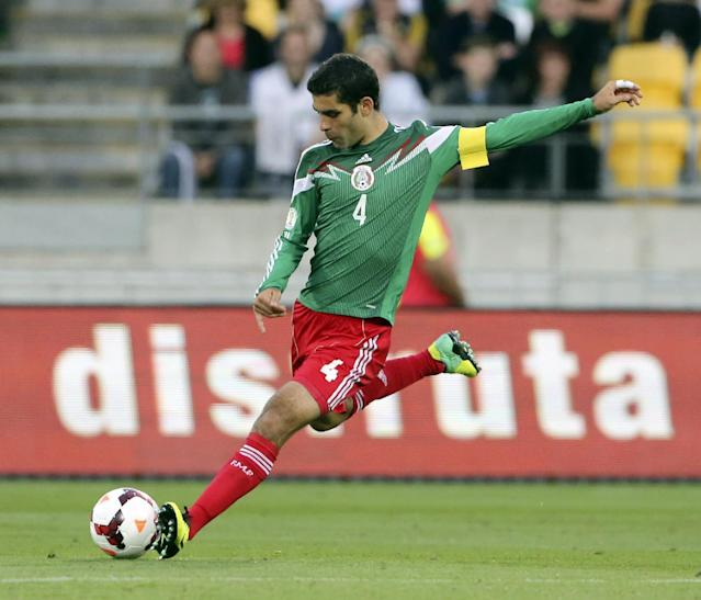 FILE - In this Nov. 20, 2013, file photo, Mexico's Rafael Marquez kicks the ball during his team's World Cup qualifying soccer match against New Zealand at Westpac Stadium, in Wellington, New Zealand. Marquez has made Mexico's World Cup roster for the fourth time. The 35-year-old defender, who captained Mexico at the 2010 tournament, was among 23 players selected Friday by Miguel Herrera, hired last October as El Tri's fourth coach in six weeks. (AP Photo/SNPA, John Cowpland)