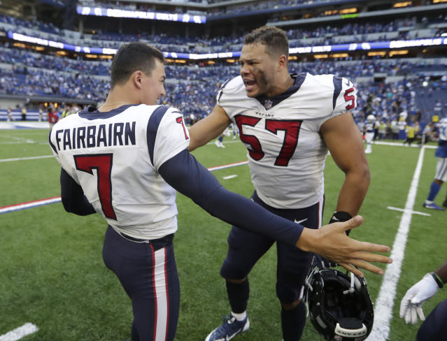Houston Texans kicker Ka'imi Fairbairn (7) celebrates with Brennan Scarlett after Fairbairn kicked the game winning field goal in overtime of an NFL football game against the Indianapolis Colts, Sunday, Sept. 30, 2018, in Indianapolis. Houston won 37-34. (AP Photo/Michael Conroy)