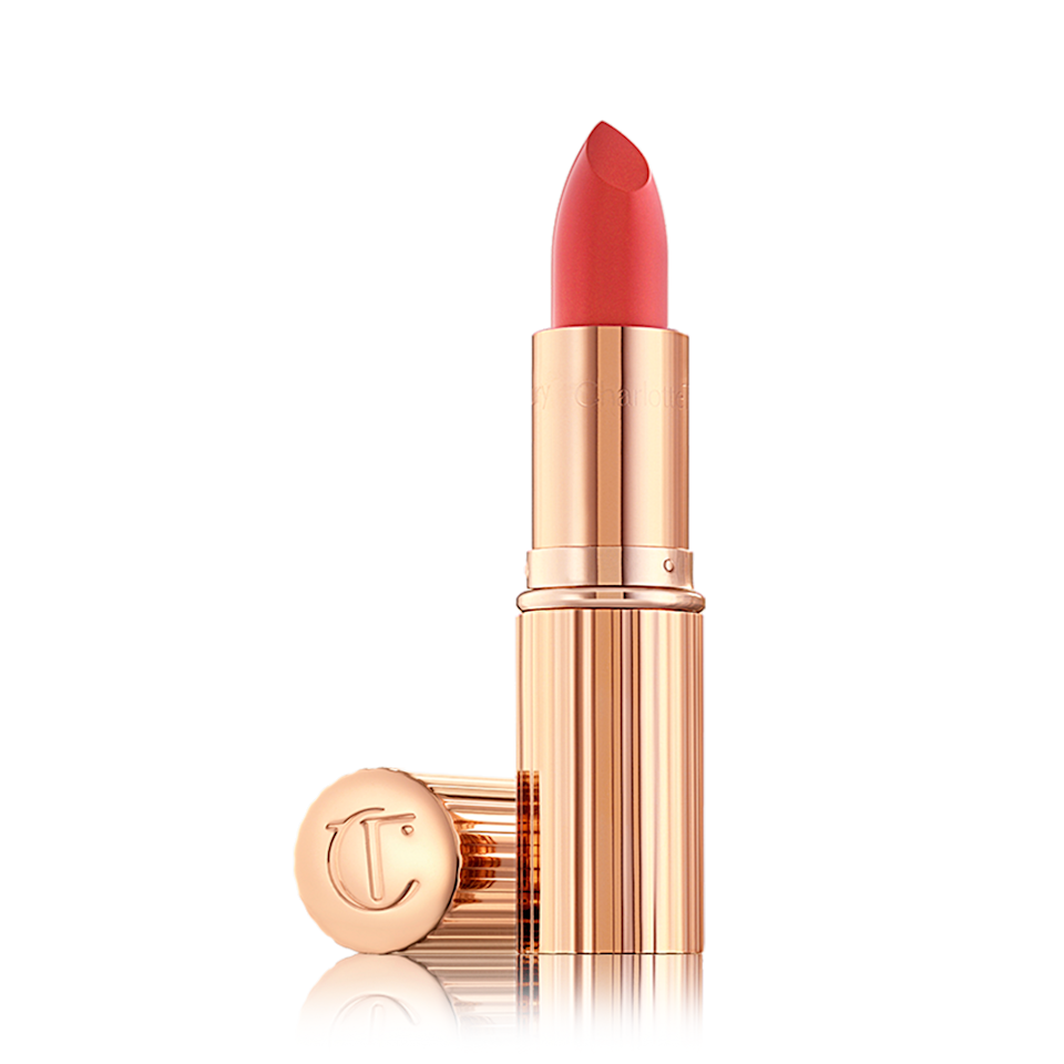"""<em>Allure</em> editors love the K.I.S.S.I.N.G Lipstick in Coral Kiss so much that we stamped a <a href=""""https://www.allure.com/gallery/best-of-beauty-lip-product-winners?mbid=synd_yahoo_rss"""" rel=""""nofollow noopener"""" target=""""_blank"""" data-ylk=""""slk:Best of Beauty Award Winner"""" class=""""link rapid-noclick-resp"""">Best of Beauty Award Winner</a> seal on it to prove our point. This satin-y lipstick has the ideal blend of <a href=""""https://www.allure.com/gallery/best-orange-lipsticks?mbid=synd_yahoo_rss"""" rel=""""nofollow noopener"""" target=""""_blank"""" data-ylk=""""slk:warm orangey"""" class=""""link rapid-noclick-resp"""">warm orangey</a>, peachy-pink tones to add a touch of brightness to any makeup look. As with all Charlotte Tilbury lipsticks, orchid extract adds a dose of lip-softening and hydrating properties. You might even forget that you're wearing lipstick at all — until you catch your reflection and mouth a tiny """"wow"""" to yourself."""