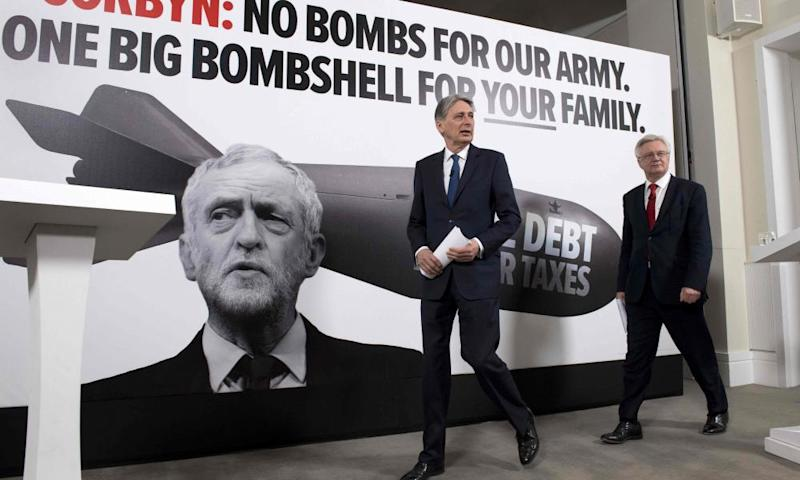 Philip Hammond and David Davis arrive for a press conference in Westminster