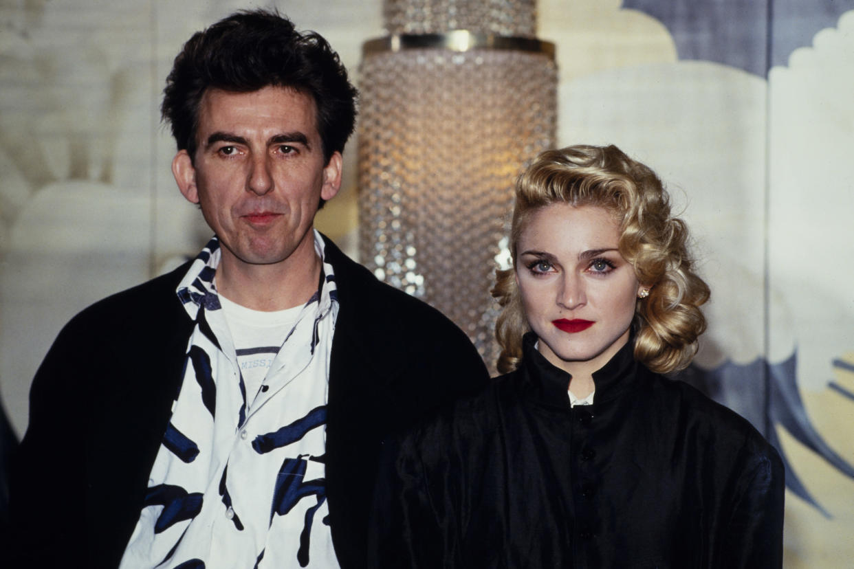 LONDON - MARCH 6: Singer Madonna holds a Press Conference with former Beatle George Harrison for their film 'Shanghai Surprise' at the Kensington Roof Gardens in London on March 6, 1986. (Photo by David Levenson/Getty Images)