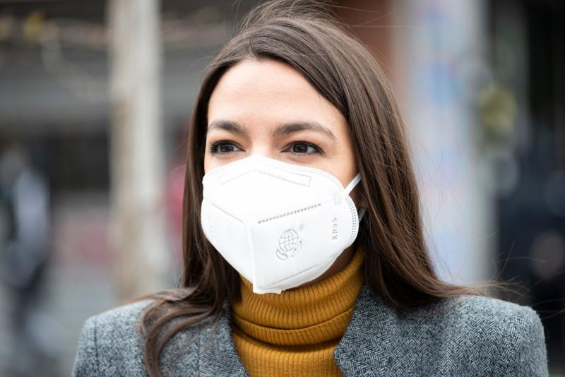 Democratic Congresswoman from New York Alexandria Ocasio-Cortez wears a face mask to protect herself from the coronavirus, during a press conference in the Corona neighbourhood of Queens on April 14, 2020 in New York City. - Senate Minority Leader Chuck Schumer and Democratic Rep. Alexandria Ocasio-Cortez hold a press conference amid the coronavirus pandemic to call on the Federal Emergency Management Administration (FEMA) to begin approving disaster funds to help families in lower-income communities and communities of color pay for funeral costs. (Photo by Johannes EISELE / AFP) (Photo by JOHANNES EISELE/AFP via Getty Images)