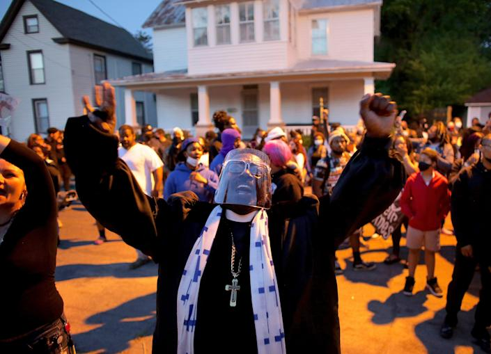 Hundreds of demonstrators, including Rev. Raymond Johnson, take to the streets in Elizabeth City, N.C. on Monday, April 26, 2021, to protest the killing of Andrew Brown Jr. by North Carolina sheriff's deputies and to demand the full body camera footage be released.