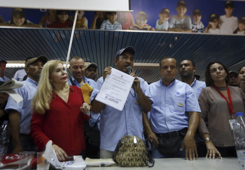 Adan Tortolero, member of General Motors's Workers Union, addresses employees at the company's plant in Valencia, Venezuela, Thursday, April 20, 2017. General Motors announced that it was shuttering operations in the country after authorities seized the factory on Wednesday. General Motors' announcement comes as Venezuela's opposition looks to keep up pressure on President Nicolas Maduro, taking to the streets again Thursday after three people were killed and hundreds arrested in the biggest anti-government demonstrations in years. (AP Photo/Juan Carlos Hernandez)