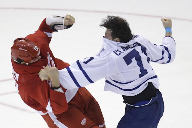 Toronto Maple Leafs right wing David Clarkson (71) fights Detroit Red Wings defenseman Jonathan Ericsson (52) of Sweden during the third period of an NHL hockey game in Detroit, Friday, Sept. 27, 2013. (AP Photo/Carlos Osorio)