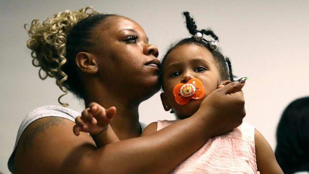 PHOTO: Tomika Miller, the wife of Rayshard Brooks, holds their daughter Memory, 2, during the family press conference, June 15, 2020, in Atlanta. (Curtis Compton/Atlanta Journal-Constitution via AP)