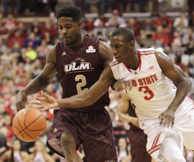 Louisiana-Monroe's DeMondre Harvey, left, and Ohio State's Shannon Scott chase the loose ball during the second half of an NCAA college basketball game, Friday, Dec. 27, 2013, in Columbus, Ohio. Ohio State defeated Louisiana-Monroe 71-31. (AP Photo/Jay LaPrete)