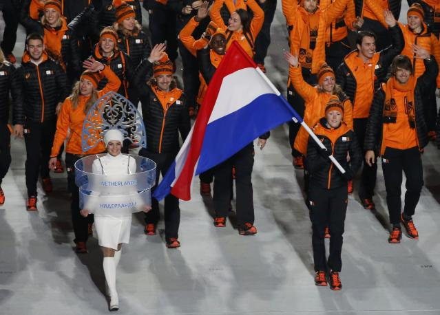 Flag-bearer Jorien ter Mors of the Netherlands leads her country's contingent during the opening ceremony of the 2014 Sochi Winter Olympics, February 7, 2014. REUTERS/Lucy Nicholson (RUSSIA - Tags: OLYMPICS SPORT)