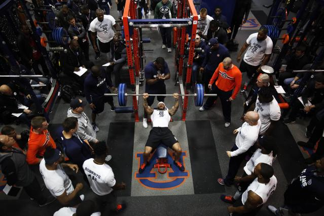 Auburn defensive back Tray Matthews begins to use the bench press during Auburn's Pro Day, Friday, March 9, 2018, in Auburn, Ala. The event is to showcase players for the upcoming NFL football draft. (AP Photo/Brynn Anderson)