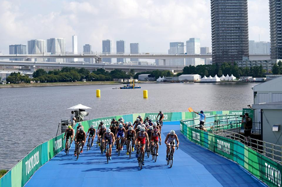 A big group formed on the bike (Martin Rickett/PA) (PA Wire)