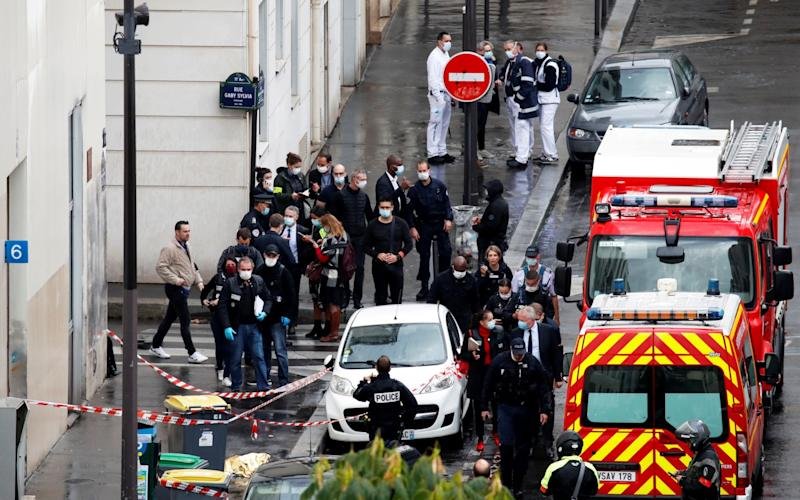 A general view as police officers investigate the scene of an incident near the former offices of French magazine Charlie Hebdo - GONZALO FUENTES/REUTERS
