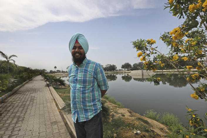 """Preet Inderpal Singh, village headman, stands at a man-made lake built by his villagers in Ranish Kalan village in Moga district of Indian state of Punjab, Saturday, March 13, 2021. Singh says, """" if people don't save every drop of water, people would become extinct, like dinosaurs."""" (AP Photo/Manish Swarup)"""