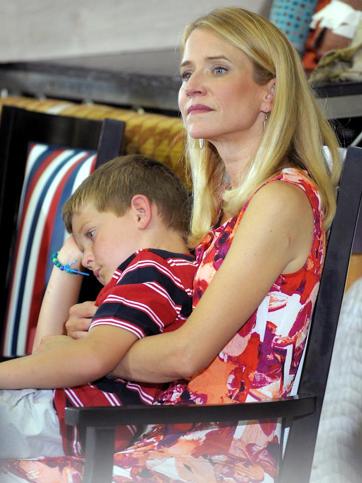 Janna Ryan holds her son Sam, while her husband Republican vice presidential candidate, U.S. Rep. Paul Ryan (R-WI) speaks during a campaign stop at the Absolute Style furniture factory on August 12, 2012 in High Point, North Carolina. Romney and Ryan continue on the second day of a 4-day bus trip that will take Romney to 4 key swing states, Virginia, North Carolina, Florida and Ohio, and also to Ryan's home state of Wisconsin. (Photo by Sara D. Davis/Getty Images)