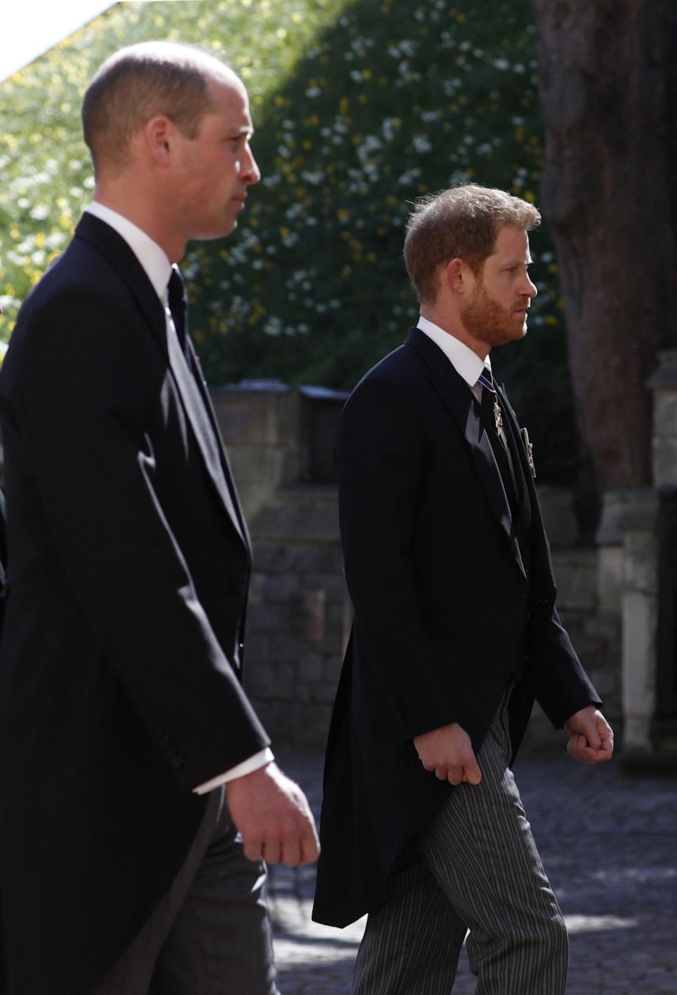 Britain's Prince William, Duke of Cambridge (C) and Britain's Prince Harry, Duke of Sussex, (R) follow the coffin during the ceremonial funeral procession of Britain's Prince Philip, Duke of Edinburgh to St George's Chapel in Windsor Castle in Windsor on April 17, 2021