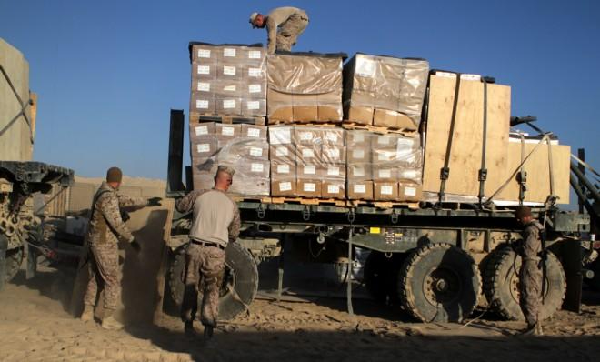 Patrol and combat supplies are unloaded on Oct. 24, 2012, in Afghanistan.