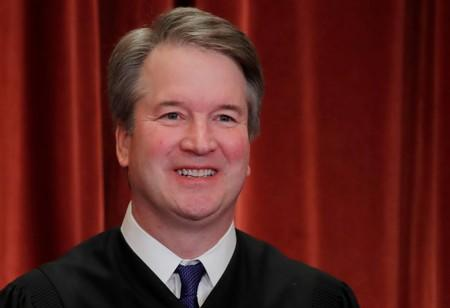 FILE PHOTO: U.S. Supreme Court Justice Kavanaugh poses during group portrait at the Supreme Court in Washington