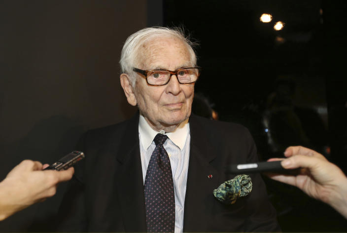FILE - In this April 10, 2014 file photo, French designer Pierre Cardin listens media questions at the Milan Design Fair, in Milan, Italy. France's Academy of Fine Arts says Pierre Cardin, the French designer whose Space Age style was among the iconic looks of 20th-century fashion, has died at 98. (AP Photo/Antonio Calanni, File)