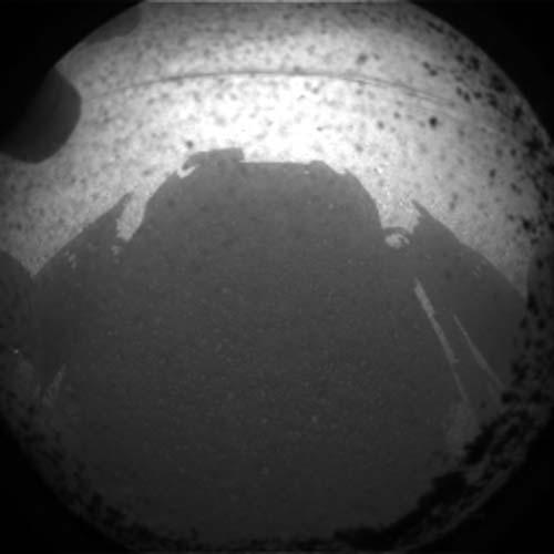 This photo shows the shadow of NASA's huge rover Curiosity on Mars just after its Aug. 5 PDT, 2012 landing in Gale Crater. This image is an enlarged version from the original 256-pixel image.