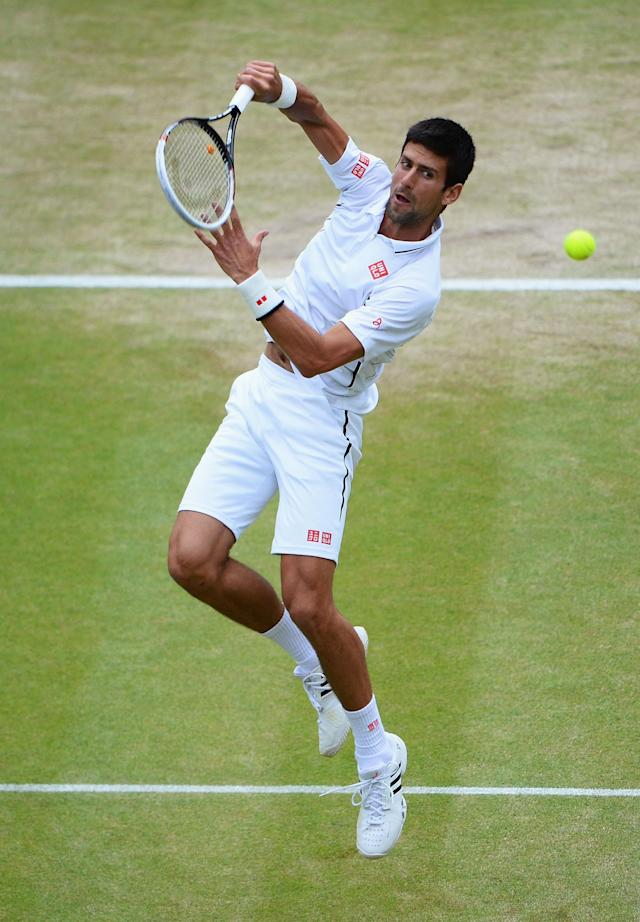 LONDON, ENGLAND - JULY 03: Novak Djokovic of Serbia leaps top smash the ball during the Gentlemen's Singles quarter-final match against Tomas Berdych of Czech Republic on day nine of the Wimbledon Lawn Tennis Championships at the All England Lawn Tennis and Croquet Club at Wimbledon on July 3, 2013 in London, England. (Photo by Mike Hewitt/Getty Images)