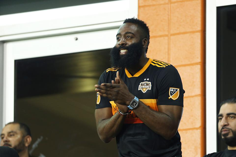 HOUSTON, TX - JULY 24: James Harden cheers for his team Dynamo during the quarterfinals match between Club America and Houston Dynamo as part of the Leagues Cup 2019 at BBVA Compass Stadium on July 24, 2019 in Houston, Texas. (Photo by Omar Vega/Getty Images)