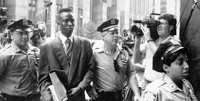"This film image released by Sundance Selects shows accused rapist Yusef Salaam being escorted by  police in New York in 1990. Salaam is the subject of the documentary, ""The Central Park Five,"" about the 1989 case of five black and Latino teenagers who were convicted of raping a white woman in Central Park. (AP Photo/Sundance Selects, NY Daily News)"