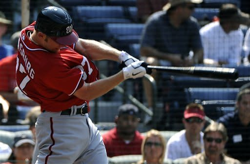 Washington Nationals' Stephen Strasburg hits an RBI-single in the second inning of their baseball game against the Atlanta Braves on Saturday, June 30, 2012, at Turner Field in Atlanta. (AP Photo/David Tulis)