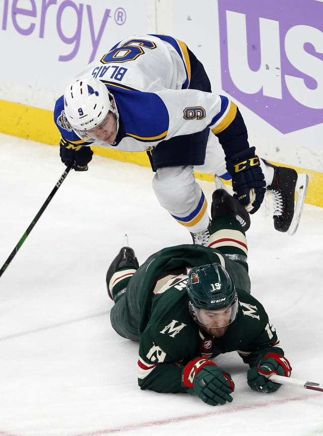 St. Louis Blues' Sammy Blais, top, topples over Minnesota Wild's Luke Kunin during the third period of an NHL hockey game Saturday, Nov. 2, 2019, in St. Paul, Minn. Blais scored moments later to tie the score. The Blues won 4-3 in overtime. (AP Photo/Jim Mone)