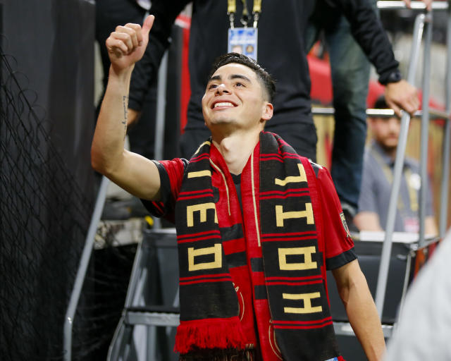 Atlanta United midfielder Miguel Almiron (10) gives a thumbs-up to fans following an MLS soccer game against D.C. United, Sunday, March 11, 2018, in Atlanta. (AP Photo/Todd Kirkland)