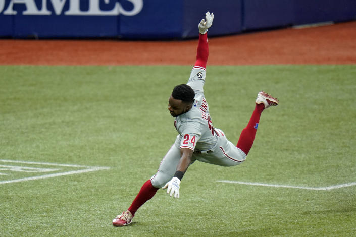 Philadelphia Phillies' Roman Quinn (24) gets injured while scoring on a two-run double by Ronald Torreyes during the fifth inning of a baseball game against the Tampa Bay Rays Saturday, May 29, 2021, in St. Petersburg, Fla. Quinn left the game. (AP Photo/Chris O'Meara)