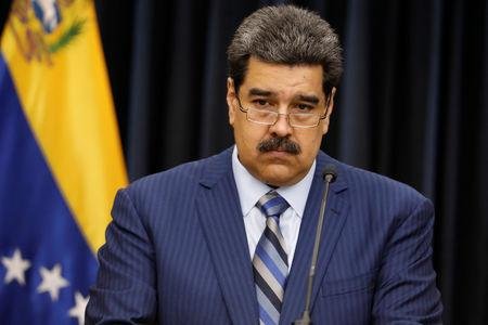 Venezuela's President Nicolas Maduro pauses as he speaks during a news conference at Miraflores Palace in Caracas