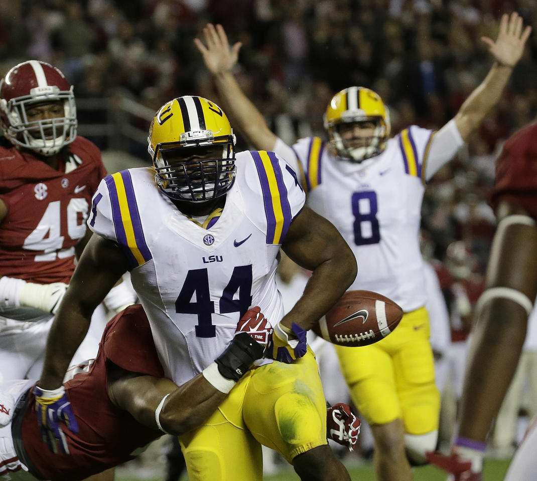 LSU fullback J.C. Copeland (44) has the ball stripped from him at the goal line by Alabama linebacker Tana Patrick (11) during the first half of an NCAA college football game, Saturday, Nov. 9, 2013, in Tuscaloosa, Ala. LSU quarterback Zach Mettenberger (8) signals a touchdown but doesn't see the loose ball. (AP Photo/Dave Martin)