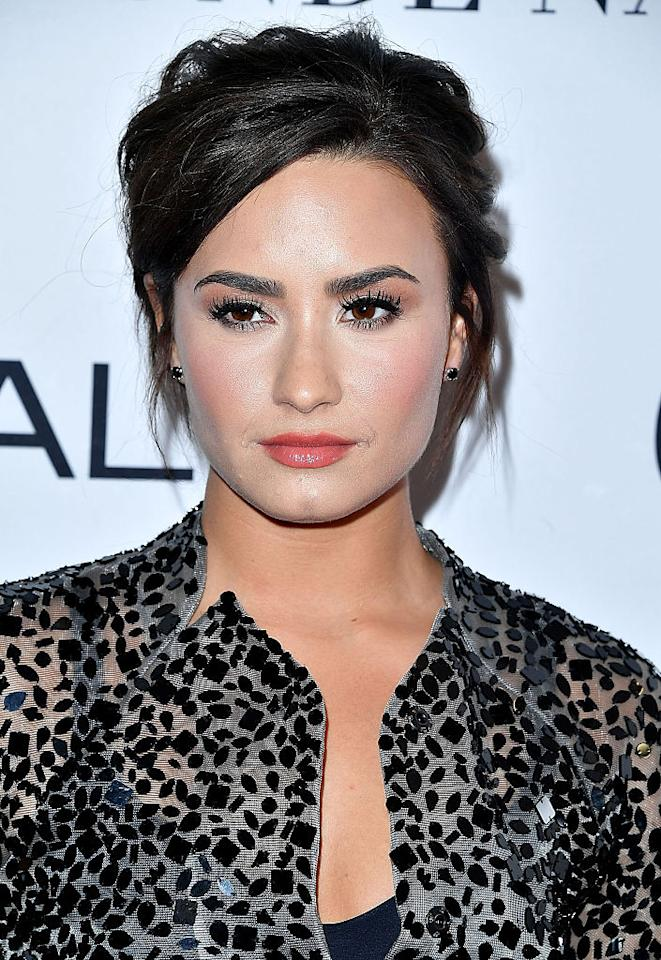 "<p>""I didn't go into treatment thinking, 'OK, now I'm going to be an inspiration,'"" Lovato explains, while Batman resumes his stride. ""At times I was resentful for having that kind of responsibility, but now, it's really become a part of my life. It holds me accountable."" — <a rel=""nofollow"" href=""https://americanwaymagazine.com/me"">Demi Lovato </a> (Photo: Getty) </p>"