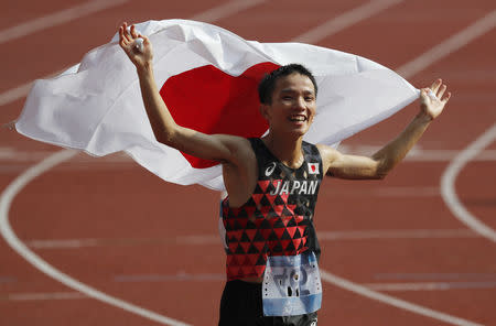 Athletics - 2018 Asian Games - Men's Marathon Final - Marathon Course - Jakarta, Indonesia - August 25, 2018 - Hiroto Inoue of Japan reacts after finishing the race. REUTERS/Darren Whiteside