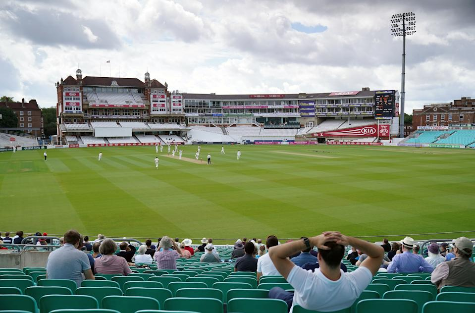 Spectators watch the action from the stands during the friendly match at the Oval on Sunday. (PA)