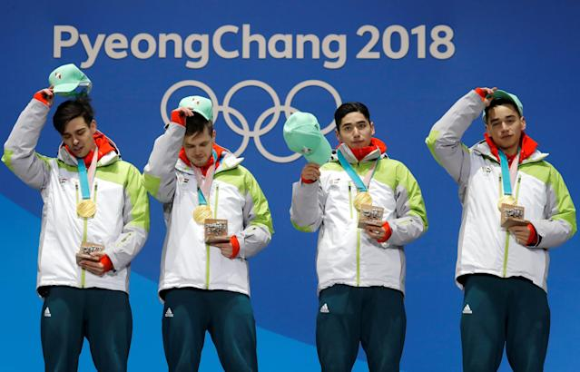 Medals Ceremony - Short Track Speed Skating Events - Pyeongchang 2018 Winter Olympics - Men's 5000m Relay - Medals Plaza - Pyeongchang, South Korea - February 23, 2018 - Gold medalists Viktor Knoch, Csaba Burjan, Liu Shaoang and Sandor Liu Shaolin of Hungary on the podium. REUTERS/Eric Gaillard TPX IMAGES OF THE DAY