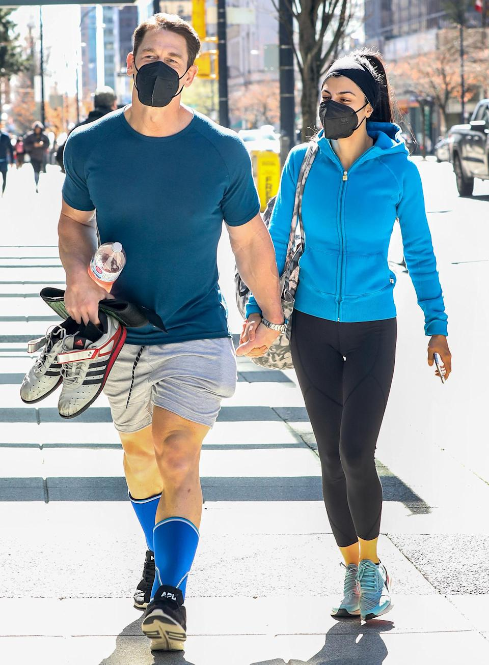<p>John Cena holds hands with wife Shay Shariatzadeh while out in Vancouver on Sunday.</p>