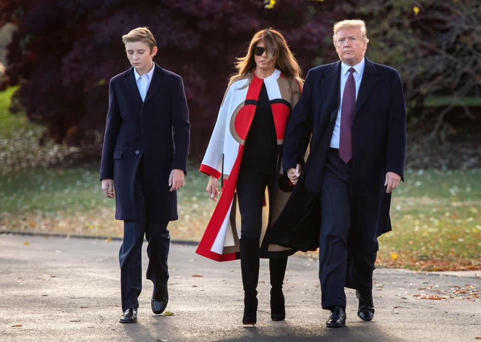 Melania Trump, pictured with President Trump and their son, Barron, wore a controversial coat to the White House turkey pardon ceremony. (Photo: Getty Images)
