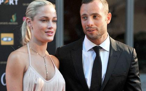 South Africa's Olympic sprint star Oscar Pistorius and his late model girlfriend Reeva Steenkamp - Credit: AFP