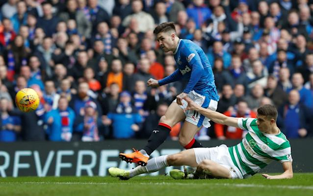 "Full time: Rangers 2-3 Celtic 1:52PM Full time, Rangers 2-3 Celtic Well, that was an absolutely classic derby. A huge roar goes up from the away end. 10-man Celtic are victorious, with Odsonne Edouard the matchwinner. 1:51PM Rangers 2-3 Celtic, 90+3 mins Alves is playing as a makeshift centre-forward now. He almost gets on a long ball into the box but Bain punches clear. 1:50PM Rangers 2-3 Celtic, 90+1 mins Bruno Alves fouls Edouard just past the halfway line and Celtic will be in no rush to take this free kick. Eventually, after much desultory dribbling, the ball goes out for a throw in over in the corner. Can Rangers come back and find a last-gasp equaliser? 1:48PM Rangers 2-3 Celtic, 90 mins Ntcham gets a yellow card for trying to prevent a Rangers free kick. There will be four minutes of added time. The tension is palpable here. 1:46PM Rangers 2-3 Celtic, 88 mins Wow. Bain makes a fantastic save from Windass, who slashes a shot towards the far corner. The rebound comes to Morelos who, despite being one of Rangers' main threats all game, can only hit the most from two yards. Bain gathers it up gratefully. Celtic fans looking triumphant at Ibrox Credit: Russell Cheyne/Reuters 1:44PM Rangers 2-3 Celtic, 87 mins Rangers probe through Morelos and Tavernier, but the quality of their crossing is still poor. 1:43PM Rangers 2-3 Celtic, 85 mins Celtic make another change, goalscorer Moussa Dembele coming off for Stuart Armstrong. 1:42PM Rangers 2-3 Celtic, 84 mins Close from Tavernier! He flicks a fizzing shot on target, but it's too close to Scott Bain who plucks it out of the air confidently. 1:41PM Rangers 2-3 Celtic, 83 mins The quality of Rangers' final ball has declined notably, with the men in blue trying a little too hard at the moment. Tavernier at least wins a free kick outside the box after a foul from Ntcham. Can Rangers make something of this? 1:38PM Rangers 2-3 Celtic, 80 mins Bain earns a yellow card for time wasting over a goal kick. Rangers get on the ball, come forward and Jamie Murphy cuts a clever ball across the box, but nobody can get on it. Time is ticking away for the Gers. 1:36PM Rangers 2-3 Celtic, 78 mins Scott Bain is fouled by Morelos and Celtic have some breathing space with a free kick. Edouard and Ntcham combine well but the latter gives away a free kick of his own. It's become a bit cagey here, unsurprisingly. 1:33PM Rangers 2-3 Celtic, 75 mins Candeias has a shot blocked from five yards, with Celtic scrambling a fraught rearguard all of a sudden. Rangers win a corner but it comes to nothing. 1:31PM Rangers 2-3 Celtic, 73 mins Brown and Ntcham are everywhere in midfield for Celtic, breaking up Rangers passing moves whenever they start to gain traction. Rangers finally work it down the right and win an attacking throw in. Before it can be taken, Sean Goss is brought off for Jason Cummings. Scott Brown has run the hard yards at Ibrox Credit: Russell Cheyne/Reuters 1:29PM Rangers 2-3 Celtic, 71 mins Rangers come forward again, desperate for an equaliser. Goss, Tavernier and Candeias exchange passes on the edge of the box, but a succession of crosses are cleared by Celtic. 1:27PM GOAL, Odsonne Edouard! Rangers 2-3 Celtic What a goal. Dembele sets up Edouard to the left of the box and he cuts inside Goss, curling a fine effort past Wes Foderingham. The 10 men lead. ODSONNE! �� What an introduction! The Hoops take the lead! #RANCELpic.twitter.com/EAfnAQYZUY— Celtic Football Club (@CelticFC) March 11, 2018 1:26PM Rangers 2-2 Celtic, 68 mins Boyata fouls up once again in defence and a combination of Kristoffer Ajer on the slide and Scott Bain is all that keeps out Morelos. 1:25PM Rangers 2-2 Celtic, 67 mins There's another substitution for Celtic, meanwhile, with Odsonne Edouard coming on for James Forrest. The corner is cleared. 66' SUB: Edouard comes on for Celtic to replace Forrest. 2-2— Rangers Football Club (@RangersFC) March 11, 2018 1:23PM Rangers 2-2 Celtic, 66 mins Dembele gives away possession with a loose pass and Tavernier wins a free kick, gifting Rangers possession. Rangers slowly turn the screw and Hendry is forced to give away a corner. 1:21PM Rangers 2-2 Celtic, 63 mins Scott Brown gives away a free kick in a dangerous position, just catching Josh Windass. Windass curls one high over the crossbar. Breathe, Celtic fans. 1:18PM Rangers 2-2 Celtic, 60 mins Jamie Murphy, who has been pretty quiet, tries one from long range but it's nowhere near the target. If Celtic can restrict Rangers to efforts like that, they won't be too worried. 1:17PM Rangers 2-2 Celtic, 58 mins Tom Rogic comes off for Jack Hendry, with Brendan Rodgers looking to restore Celtic's numbers in defence. This could be a tough half an hour for the Hoops. 1:15PM RED CARD, Jozo Simunovic! Simunovic is sent off for an elbow on Morelos, which looks a bit soft really. There was no particular sting in the movement and his eyes were on the ball, but Willie Collum has made his decision. 1:12PM Rangers 2-2 Celtic, 54 mins Celtic overplay it at the back and Scott Bain clears straight to Tavernier. Rangers win a corner but it is belted clear by Dedryck Boyata. 1:10PM Rangers 2-2 Celtic, 52 mins Deserved yellow card for Fabio Cardoso, who chops down Dembele after Rogic has sent him away through the middle. From a great position in front of the box, Ntcham fails to get it over the wall. Tom Rogic battles with Sean Goss for the ball Credit: Jeff Holmes/PA 1:09PM Rangers 2-2 Celtic, 51 mins Callum McGregor gets in behind after some midfield head tennis, but his cut-back across the Gers box is cleared. 1:07PM Rangers 2-2 Celtic, 49 mins Tom Rogic fouls Sean Goss just outside Celtic's final third and Rangers prepare to send a long ball into the area. Goss floats one in but it is cleared easily by Scott Brown. 1:06PM Rangers 2-2 Celtic, 48 mins Dembele gets a snap chance in the box after a good run and cross from Kieran Tierney, but slices it wide. 1:04PM Rangers 2-2 Celtic, 46 mins James Tavernier dispossesses Olivier Ntcham and roars into the box, but Alfredo Morelos can't get a cross in. Celtic charge up the other end of the pitch and Moussa Dembele tees up Ntcham on the edge of the area, but he sends a floaty shot into the stratosphere. 1:01PM Teams back out Let's hope for more of the same in the second half. If so, fans could be talking about this game for a long time to come. RESTART- The home side kick-off the second half here at Ibrox [2-2] #RANCEL— Celtic Football Club (@CelticFC) March 11, 2018 12:48PM Half-time, Rangers 2-2 Celtic Phwoar. If the second half is anything like the first, this will be the undisputed game of the season. It's anyone's game with both sides playing brilliantly in fits and bursts, though Dembele's equaliser may well act as a gut-punch to the Gers. 12:46PM GOAL, Moussa Dembele! Rangers 2-2 Celtic What a sickener for Rangers, what a beautiful goal for Celtic. A long ball up from Scott Brown at the back finds Dembele, who charges into the box under pressure and chips the onrushing Wes Foderingham. This game is honestly exhilarating. GET IN! Another Glasgow Derby goal for Moussa - Broony instrumental! Come on! #RANCELpic.twitter.com/MheF5HF7bb— Celtic Football Club (@CelticFC) March 11, 2018 12:45PM Rangers 2-1 Celtic, 43 mins Morelos is given a warning after thumping into Scott Brown. The first card of the game is then shown to Sean Goss for a crude challenge on Tierney to the left of the area. Ntcham stands over it but leaves it for McGregor, whose threatening delivery is cleared by Alves. 12:43PM Rangers 2-1 Celtic, 42 mins Celtic are finishing the half strongly here. Callum McGregor twists and turns into space on the edge of the Rangers box and shoots low, but Foderingam saves it. 12:41PM Rangers 2-1 Celtic, 40 mins Celtic get their seventh corner of the game and Foderingham flaps at it. Dembele attempts a bicycle kick with the keeper stranded off his line. It slams into a wall of blue shirts. So close for Celtic. 12:39PM Rangers 2-1 Celtic, 39 mins Celtic win another corner and Dembele thumps a downwards header at goal. It looks like it might go in, but Foderingham manages to palm it wide. 12:38PM Rangers 2-1 Celtic, 37 mins James Forrest wins a free kick in a good position in front of the box, with several players including Dembele standing over it. Dembele sends a deep cross in, which is cleared by Alves. Ntcham's corner comes to Boyata, but is hooked clear. James Forrest in action for Celtic Credit: Russell Cheyne/Reuters 12:37PM Rangers 2-1 Celtic, 35 mins Morelos absolutely destroys Simunovic with a nutmeg to the right of the box, but again there are no blue shirts rushing onto his killer ball across the box. If Rangers were better able to exploit Morelos' supremacy on his flank, they could be even further ahead here. 12:35PM Rangers 2-1 Celtic, 32 mins Moussa Dembele stretches Bruno Alves in defence, with the Gers man forced to give away a corner. Ntcham's delivery is cleared at the first time of asking but Celtic retain possession. Eventually, Rogic tries another effort from distance, but Foderingham gets to this one. 12:32PM Rangers 2-1 Celtic, 30 mins James Tavernier makes an interception in midfield and send Morelos away down the right. He skins Boyata for pace and fires a low cross straight across the goal line, but nobody in blue can get a toe to it. 12:29PM Rangers 2-1 Celtic, 28 mins Celtic come back at Rangers and win another corner, which is pinged to the near post and easily cleared. 12:28PM GOAL, Daniel Candeias! Rangers 2-1 Celtic Declan John, who has been rampant so far, gets in behind the Celtic defence on the left and sends a bouncing cross into the box. Nobody clears it, Bain stays on his line and it comes through to Candeias, who rifles home. 26' GOAL! GOAL! @Dcandeias11 smashes the ball into the back of the net! 2-1 pic.twitter.com/wdR4Yefu3X— Rangers Football Club (@RangersFC) March 11, 2018 12:25PM Rangers 1-1 Celtic, 24 mins Olivier Ntcham fires a beautiful cross-field ball to Forrest, who wins a corner. Ajer gets a head on it and nods down to Jozo Simunovic, but he slashes over the crossbar. That was a decent opportunity for Celtic. 12:23PM Rangers 1-1 Celtic, 21 mins Declan John latches onto a long ball and slaloms into the box past Kristoffer Ajer, but he goes for glory himself and thumps an effort over the bar. 12:21PM Rangers 1-1 Celtic, 20 mins Boyata almost gives the ball away again in a dangerous position, this time to Candeias. The Hoops defender's first touch has been leaden so far. 12:19PM Rangers 1-1 Celtic, 19 mins There's a slight lull as both teams attempt to get a grip on a thrilling game, before Daniel Candeias gets on the ball and whips a low cross across the Celtic box from the right. Scott Bain is wise to it and cuts it out early. 12:14PM Rangers 1-1 Celtic, 13 mins David Bates is down after seemingly turning his ankle, so Graeme Murty brings on Fabio Cardoso in his place. 12:12PM GOAL, Tom Rogic! Rangers 1-1 Celtic Thriker! Tom Rogic smashes one in from outside the box after a storming run. In the Telegraph offices, there was a collective ""OOF"". Game on! YES! TOM WITH THE EQUALISER! What a finish! #RANCELpic.twitter.com/cQrL5FI2SG— Celtic Football Club (@CelticFC) March 11, 2018 12:11PM Rangers 1-0 Celtic, 10 mins Celtic are starting to get a grip on possession, though Rangers are harassing them frantically. Wes Foderingham fumbles a long ball into the box and palms it straight to a green-and-white shirt, but it's scrambled clear. 12:08PM Rangers 1-0 Celtic, 7 mins Chance for Tierney! A nice passing move from Celtic sees Tierney get in behind the Rangers back line, but his cross-come-shot trickles across the face of goal and is cleared. 12:07PM Rangers 1-0 Celtic, 6 mins First stonking foul of the game as Declan John scythes down James Forrest. Would have been a yellow in literally any other fixture, but there we go. 12:04PM GOAL, Josh Windass! Rangers 1-0 Celtic Dedryck Boyata makes a disastrous mistake in defence, losing the ball to Josh Windass who races through one-on-one. To the right of goal, with the angle narrowing, he hammers one in past debutant Scott Bain. What a start to the game. 3' GOOOOAAAALLLL!!! @WindassJnr gives #RangersFC the lead! 1-0 pic.twitter.com/BM02gwyXXJ— Rangers Football Club (@RangersFC) March 11, 2018 12:02PM Rangers 0-0 Celtic, 2 mins Rangers make a bright start, Alfredo Morelos testing Kieran Tierney out on the right. Rangers have an attacking throw in, but can't make anything of it. 12:01PM Willie Collum the referee Before he was a ref, he taught religious education apparently. No comment. 11:56AM Kick off imminent ... and the teams are ready to go. Let's football! �� Match ready. #RANCELpic.twitter.com/lRWeu0ACan— Celtic Football Club (@CelticFC) March 11, 2018 11:55AM Head-to-head record Rangers haven't beaten Celtic in seven league games, their last Scottish Premiership victory coming all the way back in March 2012. Despite their good recent run, it will take some performance for the Gers to triumph over the league leaders here. 11:37AM Dorus de Vries out with ankle injury The big team news today is that Dorus de Vries is out, so on-loan Dundee goalkeeper Scott Bain comes in for his Celtic debut. What a day for it. 11:33AM Murty talks team selection �� PRE MATCH: Graeme Murty spoke to @RangersTV to discuss his team selection ahead of today's match. pic.twitter.com/MvTszRAz4b— Rangers Football Club (@RangersFC) March 11, 2018 11:32AM Graeme Murty on Celtic's league position With Celtic six points clear of Rangers at the top of the Scottish Premiership, Graeme Murty has admitted the Gers still have some way to go to catch up with their fierce rivals. ""Celtic have done it. They are top of the league,"" he said. ""We're still chasing them and whether we chase them down or not won't just be on this one game – it will be on the games after it, so we have to make sure that what we do, from Sunday, is put ourselves in as good a position as possible. But we have to continue our improvement, because we're not the finished article as yet."" Graeme Murty has presided over a gradual upswing in Rangers' fortunes Credit: Graham Stuart/PA 11:26AM Brendan Rodgers on Rangers' growing confidence ""It tells you they expect to win, and their supporters expect them to win, but we'll do our talking on the pitch,"" said Rodgers of the ""confident noises"" coming out of Ibrox in the build-up to matchday. ""We also respect our opposition and we'll focus on what we're trying to do."" Brendan Rodgers has urged his players to do their talking on the pitch Credit: Mark Runnacles/Getty Images 11:18AM Atmosphere building at Ibrox Who's ready for the Old Firm derby then? ""There is no Old Firm!"" a thousand voices cry, hence getting us in the mood for probably the most contentious fixture in Britain. Rangers fans gather ahead of kick off Credit: Russell Cheyne/Reuters 11:09AM Rangers team news ⚽️ TEAM NEWS: Three changes to today's team to face Celtic with Wes Foderingham, Declan John and Jamie Murphy returning to the side. pic.twitter.com/4OV1grihIT— Rangers Football Club (@RangersFC) March 11, 2018 11:08AM Celtic team news �� The team news is in, Celts! Here's your #CelticFC starting XI for today's derby. #RANCELpic.twitter.com/MpZs6I5gMf— Celtic Football Club (@CelticFC) March 11, 2018 11:04AM Match preview Rangers manager Graeme Murty is confident his players can handle the pressure of their eagerly awaited tussle with Celtic. But he has reminded them to focus on carrying on their good work on the pitch once they have dealt with the atmosphere of Sunday's Ibrox derby. Rangers have scored 23 goals during six consecutive wins and their confidence was evident when the players cheered last weekend's Scottish Cup draw after they were paired with their city rivals. However, Celtic manager Brendan Rodgers pointedly remarked they had lost to Hibernian at Ibrox in their most recent major contest and the visitors will be looking to test their hosts' nerve. Murty said: ""People come north of the border to this club to play in big games. I'm not sure there is a bigger game for us to play in currently. So this game has added significance. ""But anyone who comes to this football club has to understand the history and passion behind it, and make sure they deal with that first and foremost so they can concentrate on being as good as they have been in the previous weeks. Murty is confident his players can handle the pressure Credit: Andrew Milligan/ PA ""I'm confident the players we have brought in in January and the players who were here before understand the scale of the game. ""We know walking into Ibrox, teams are under pressure, ourselves included. Handling that pressure is something we have done historically really well at this football club. But whilst we walk out on to the football pitch ready to accept it, what we can do on the pitch will determine what is going to happen after that."" Murty has secured two draws at Celtic Park but Sunday will be his first taste of the fixture at Ibrox. ""I'm desperate to experience the atmosphere,"" he said. ""Obviously I have been to their ground, and I enjoyed the atmosphere, but this is ours, and this will be special. ""To be a manager of Rangers Football Club in an Old Firm game at home will be possibly the biggest moment of my career so far. It's something I am really looking forward to. ""I will reiterate though, I will really enjoy those things when you do your job properly."" PA"