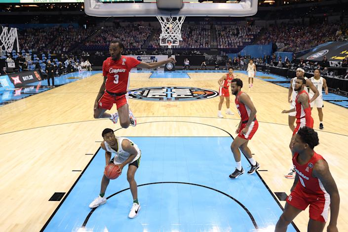 INDIANAPOLIS, INDIANA - APRIL 03: DeJon Jarreau #3 of the Houston Cougars defends a shot by Jared Butler #12 of the Baylor Bears in the first half of their Final Four semifinal game of the 2021 NCAA Men's Basketball Tournament at Lucas Oil Stadium on April 03, 2021 in Indianapolis, Indiana. (Photo by Jamie Schwaberow/NCAA Photos via Getty Images)
