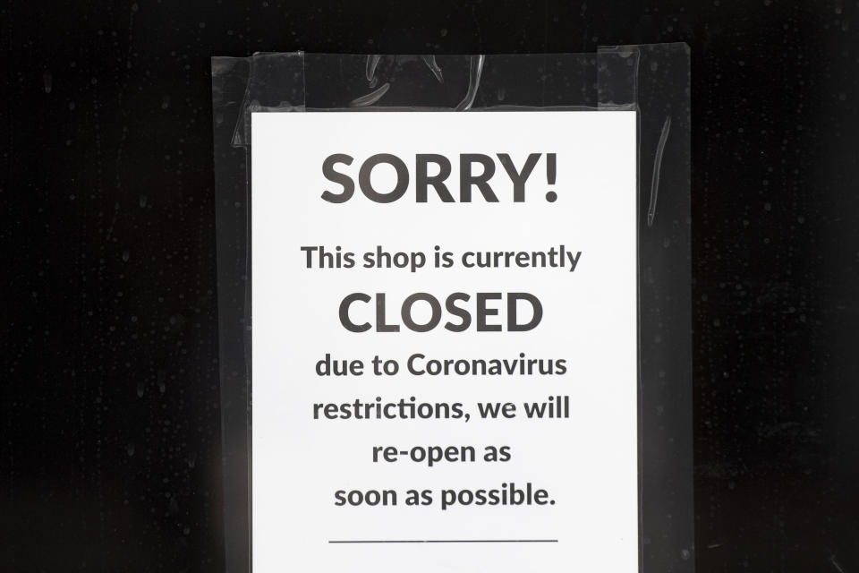 CARDIFF, UNITED KINGDOM - MAY 21: A sign in the window of a closed small business on May 21, 2020 in Cardiff, United Kingdom. The British government has started easing the lockdown it imposed two months ago to curb the spread of Covid-19, abandoning its 'stay at home' slogan in favour of a message to 'be alert', but UK countries have varied in their approaches to relaxing quarantine measures. (Photo by Matthew Horwood/Getty Images)
